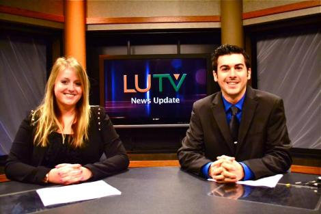 Alex Ferrario and myself on the anchor desk, as we conquered our first time this semester.